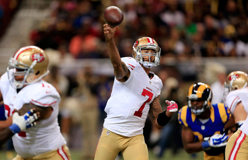 . San Francisco 49ers quarterback Colin Kaepernick (7) passes against the St. Louis Rams in the first quarter of an NFL football game Monday, Oct. 13, 2014, in St Louis. (AP Photo/Billy Hurst)