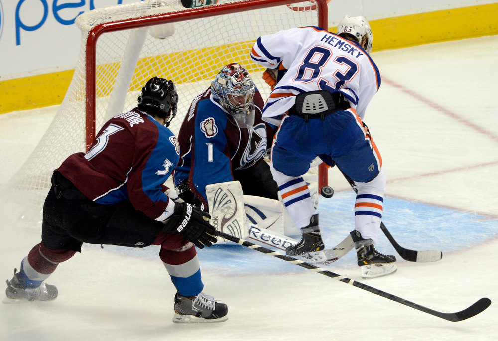 . DENVER, CO. - FEBRUARY 2ND: Colorado Avalanche goalie, Semyon Varlamov, blocks a shot by Sam Gagner,  Edmonton Oilers, Ryan O\'Byrne, left, defends in the second period at the Pepsi Center in Denver Colorado, February 2nd, 2013.  (Photo By Andy Cross / The Denver Post)