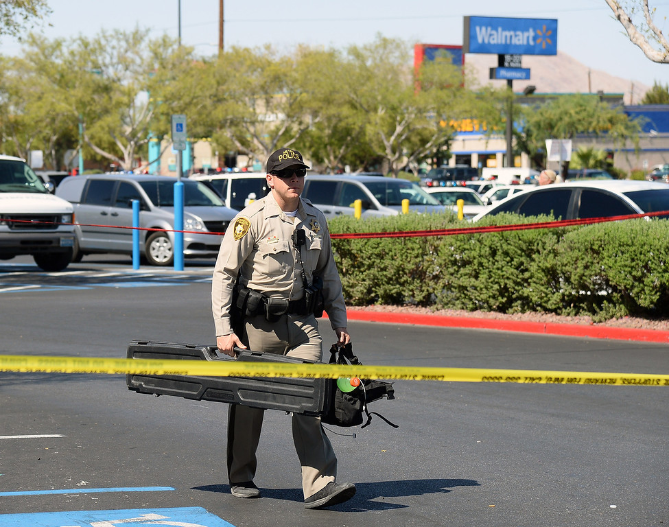. A Las Vegas  Metropolitan Police Department officer removes equipment from a Wal-Mart on June 8, 2014 in Las Vegas, Nevada.  (Photo by Ethan Miller/Getty Images)