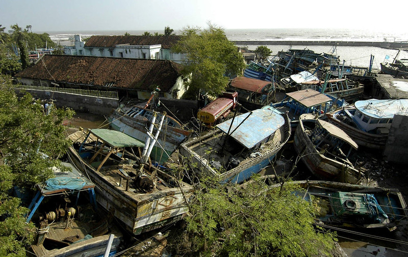 . Damaged fishing boats lie entwined in the wreckage of houses in the port of Nagapattinam, some 350 km south of Madras, 28 December 2004, after tidal waves hit the region.  The death toll in India from giant tidal waves that crashed into the coasts of Asia has crossed 7,500 with tens of thousands of people missing, officials said. The death toll of 7,523 included 3,000 in the Andaman and Nicobar Islands, close to the epicenter of the Indonesian earthquake that caused the tsunamis, and another 4,500 in the southern Indian state of Tamil Nadu and the former French colony of Pondicherry, officials and the Press Trust of India said.  PRAKASH SINGH/AFP/Getty Images
