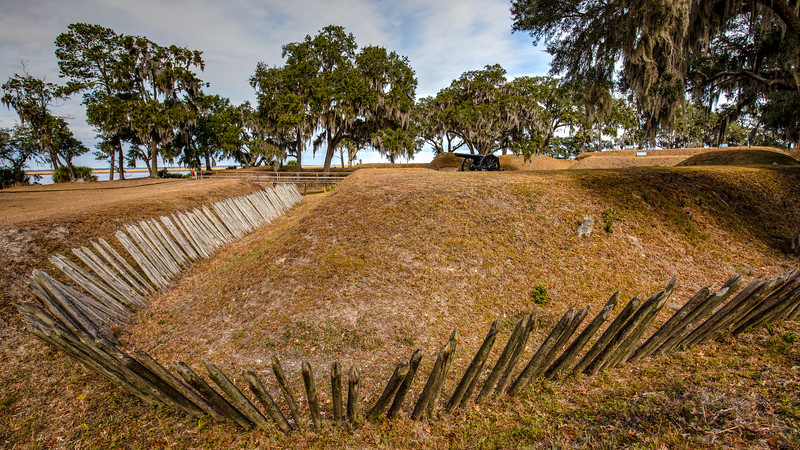 Palisades, wooen stakes, were used to protect the earthen fort from a land attack.