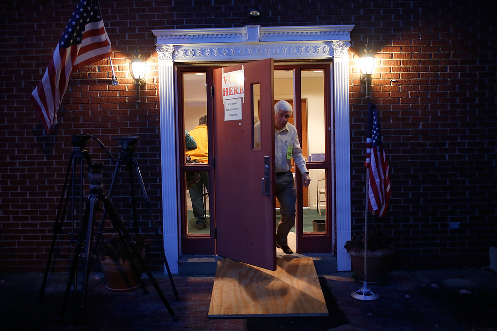 . An election official opens the door at the polling station located at Pleasant Green Baptist Church November 4, 2014 in Lexington, Kentucky. The United States holds its midterm election today, with control of the U.S. Senate at stake in the vote.  (Photo by Win McNamee/Getty Images)