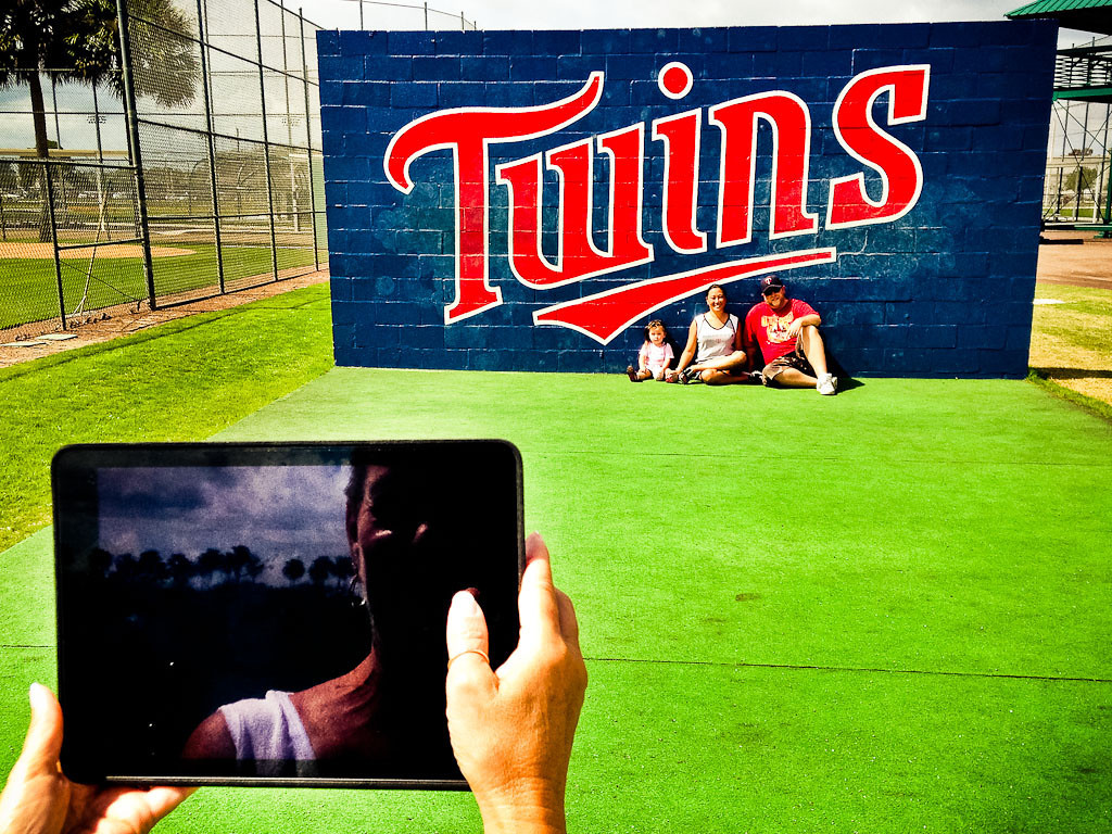 . A fan uses a tablet to make a souvenir photo of their visit to the Lee County Sports complex. (Pioneer Press: Ben Garvin)