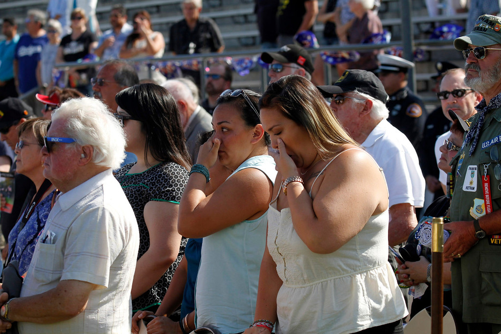 ". Guests are brought to tears during the ""Last Bugle Call\"" during the Vietnam Veterans Memorial \""The Wall That Heals\"" Closing Ceremony event, at La Habra High School, in La Habra, Sunday, July 14, 2013. (SGVN/Correspondent Photo by James Carbone)"