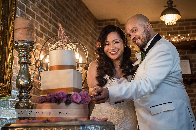 bride and groom cutting wedding cake at Sunol's Casa Bella