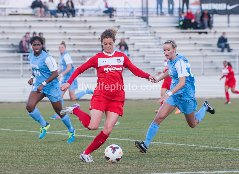 Christine Nairn of the Washington Spirit drops in to clear a ball from the box.