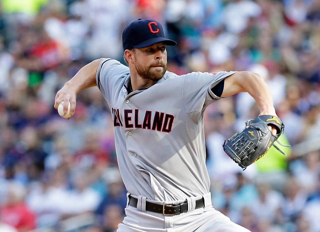 . Cleveland Indians pitcher Corey Kluber throws in the first. (AP Photo/Jim Mone)