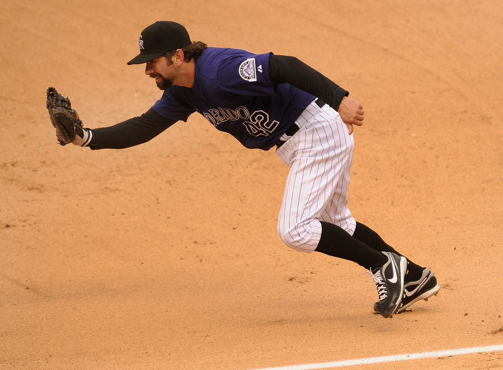 . Rockies first baseman Todd Helton made an unassisted out on Mets batter Daniel Murphy in the fifth inning. The Colorado Rockies hosted the New York Mets in a make up game Tuesday afternoon, April 16, 2013. Monday night\'s game was snowed out at Coors Field.  Photo By Karl Gehring/The Denver Post)