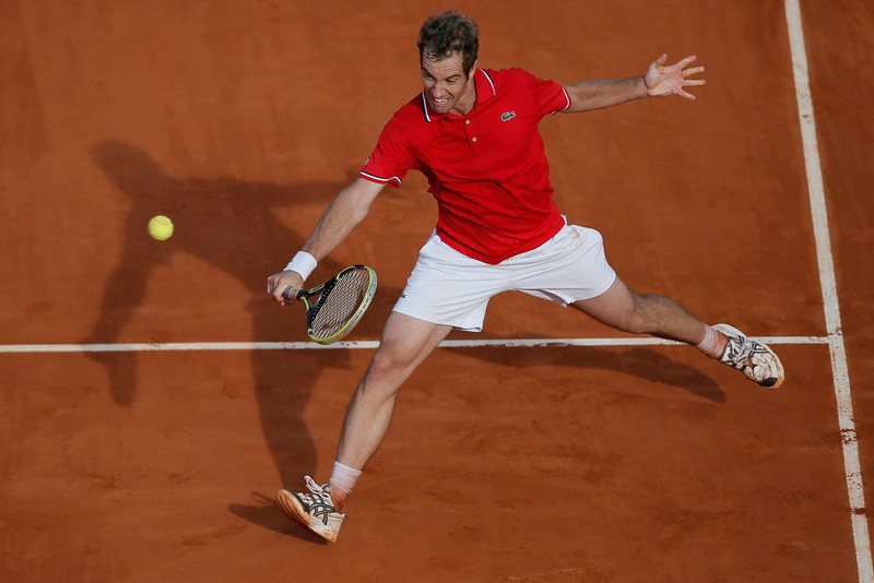 . Richard Gasquet of France returns against Switzerland\'s Stanislas Wawrinka in their fourth round match at the French Open tennis tournament, at Roland Garros stadium in Paris, Monday June 3, 2013. (AP Photo/Petr David Josek)