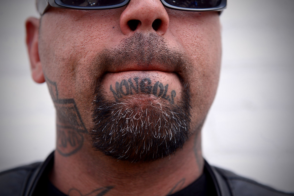 . Mongol Bibi, of Riverside, shows his club name as motorcycle club members rally Saturday, March 29, 2013 at The House Lounge in Maywood in support of the Mongols who are facing a federal trial seeking to take away their trademark patch. (Photo by Sarah Reingewirtz/Pasadena Star-News)