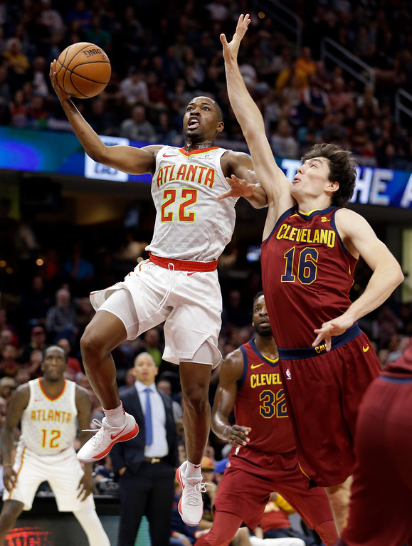 . Atlanta Hawks\' Isaiah Taylor (22) drives to the basket against Cleveland Cavaliers\' Cedi Osman (16), from Turkey, in the first half of an NBA basketball game, Sunday, Nov. 5, 2017, in Cleveland. (AP Photo/Tony Dejak)