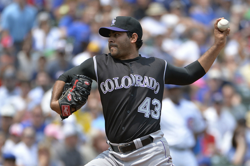 . Starting pitcher Pedro Hernandez #43 of the Colorado Rockies delivers a pitch during the first inning against the Chicago Cubs at Wrigley Field on July 31, 2014 in Chicago, Illinois.  (Photo by Brian Kersey/Getty Images)