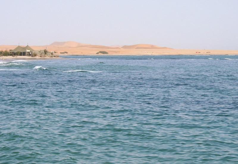 "dunes by the atlantic.  swakopmund.  google earth: 22º40'50.85""S  14º31'13.78""E"