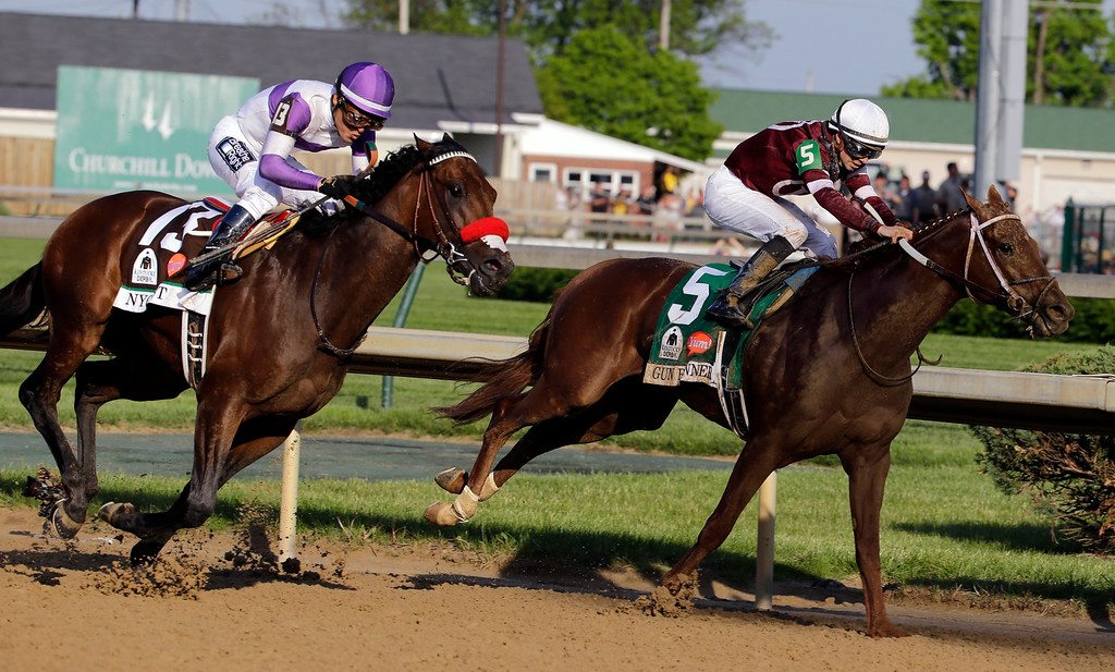 . Mario Guitierrez rides Nyquist past Gun Runner during the 142nd running of the Kentucky Derby horse race at Churchill Downs Saturday, May 7, 2016, in Louisville, Ky. (AP Photo/Julio Cortez)