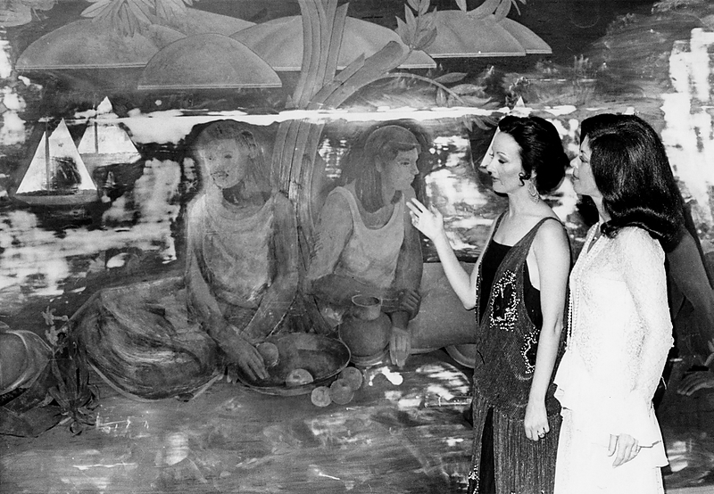 . Mrs. Edward Becker, of Oakland, left, and Mrs. Lester Finkel, of Piedmont, dressed in period costume, admire one of the original murals in the women\'s smoking lounge in April 1973. (Kenneth Green/Bay Area News Group Staff Archives)