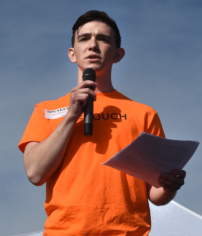 . Caden McGhie, a former Parkland student who now attends Fairview, talks to the crowd at Fairview High School in Boulder. Students at schools across Boulder County and Broomfield walked out of class around 10 this morning as they took part in the nationwide protest of gun violence on the one-month anniversary of the massacre at a high school in Parkland, Fla., that left 17 dead. Cliff Grassmick  Photographer  March 14, 2018