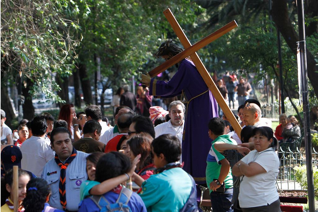 . People who were participating in a Holy Week procession stop after a strong earthquake jolted Mexico City, Friday, April 18, 2014. A powerful magnitude-7.2 earthquake shook central and southern Mexico but there were no early reports of major damage or casualties. (AP Photo/Marco Ugarte)