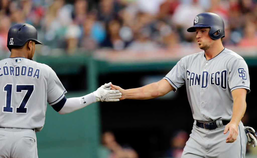 . San Diego Padres\' Hunter Renfroe, right, is congratulated by Allen Cordoba after Renfroe scored on Erick Aybar\'s ground rule double in the fifth inning of a baseball game, Thursday, July 6, 2017, in Cleveland. (AP Photo/Tony Dejak)