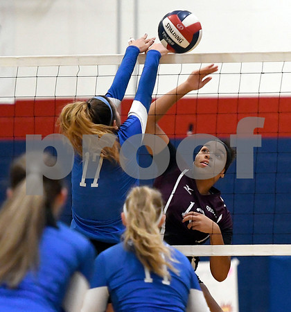 10/19/2017 Mike Orazzi   Staff Plainville's Katharine Tanguay (17) and Bristol Central's Xia'ian Carrasco (13) during Thursday's volleyball match in Plainville.