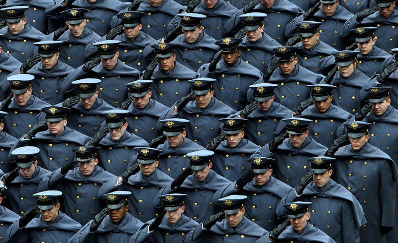 . Army Cadets salute as they parade on the field before an NCAA college football game between the Army and the Navy Saturday, Dec. 8, 2012, in Philadelphia. (AP Photo/Matt Rourke)