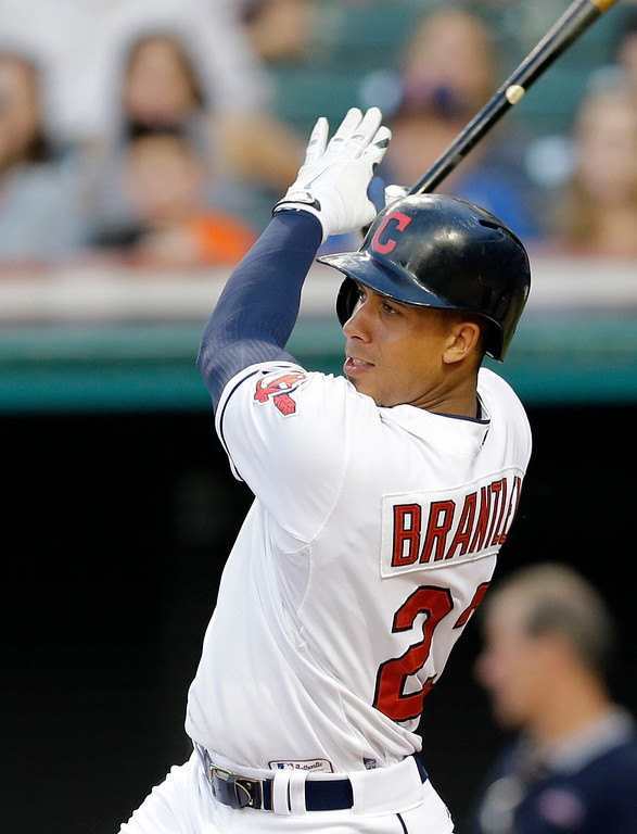 . Cleveland Indians� Michael Brantley hits an RBI-single off Detroit Tigers pitcher Kyle Ryan in the third inning of a baseball game Monday, June 22, 2015, in Cleveland. Jason Kipnis scored on the play. (AP Photo/Tony Dejak)