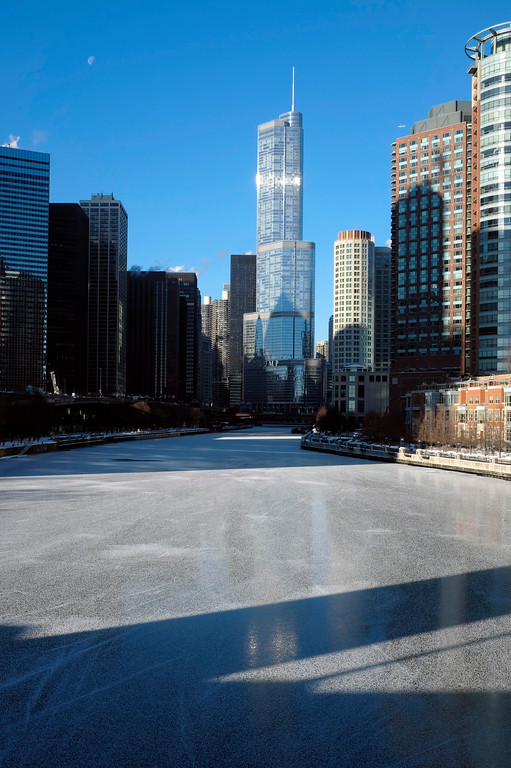 . Ice forms on Chicago River, Monday, Dec. 19, 2016, in downtown Chicago. Lingering arctic air and wind also has combined for dangerous subzero wind chills, though the National Weather Service forecast calls for temperatures to warm into the upper teens and twenties during the day. (AP Photo/Kiichiro Sato)