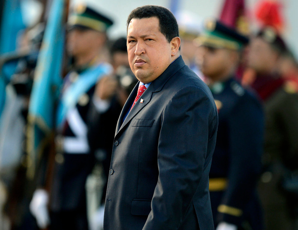 . A photo taken on July 03, 2012 shows Venezuelan President Hugo Chavez walking during a promotion ceremony in Caracas. President Hugo Chavez returned to Venezuela early on February 18, 2013 after spending more than two months in Cuba for cancer surgery and treatment, announcing his surprise homecoming via Twitter. JUAN BARRETO/AFP/Getty Images