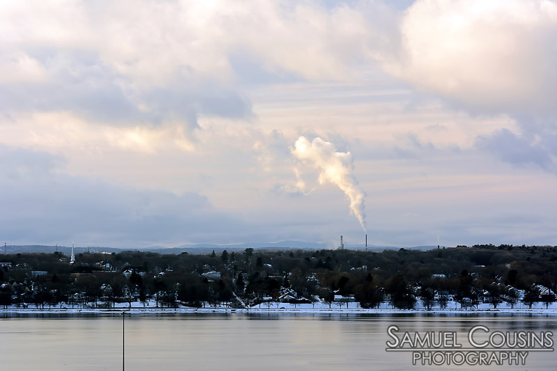 Smoke (or steam) from a stack across the bay.