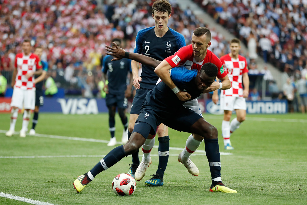 . Croatia\'s Ivan Perisic and France\'s Paul Pogba battle for the ball during the final match between France and Croatia at the 2018 soccer World Cup in the Luzhniki Stadium in Moscow, Russia, Sunday, July 15, 2018. (AP Photo/Natacha Pisarenko)