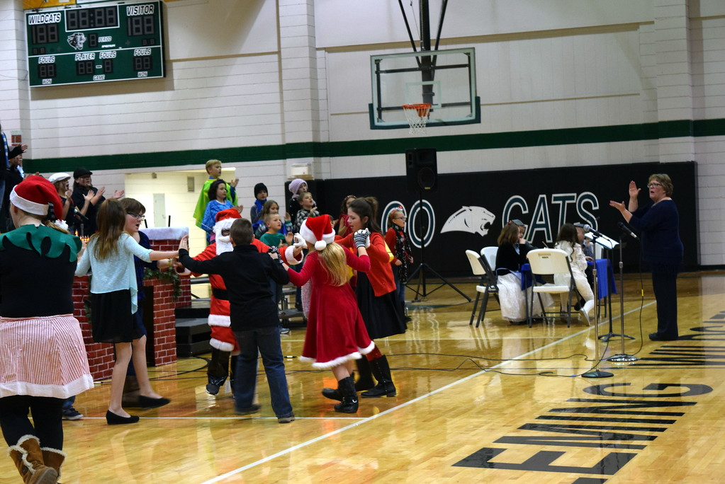 """. Fleming Elementary second through fourth graders dance as their classmates sing \""""Lotsa Latkes\"""" during the school\'s production of \""""Once on a Housetop\"""" Monday, Dec. 11, 2017."""
