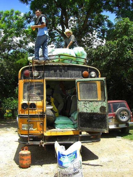 Men Loading Chicken Bus - Marcala, Honduras