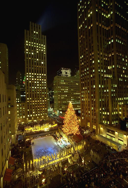 . A 90-foot Norway spruce is set aglow with 26,000 lights at the 64th annual lighting of the Rockefeller Center tree Wednesday, December 3, 1996, at New York\'s Rockefeller Center. (AP Photo/Mark Lennihan)