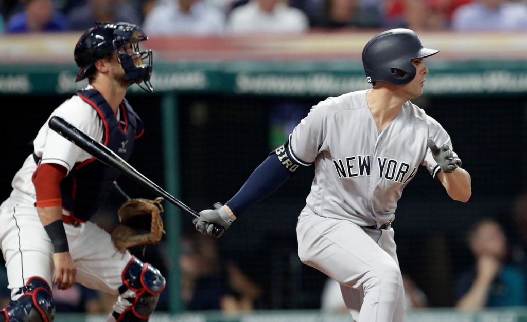 . New York Yankees\' Greg Bird watches his sacrifice fly off Cleveland Indians relief pitcher Oliver Perez during the eighth inning of a baseball game Thursday, July 12, 2018, in Cleveland. Aaron Hicks scored on the play. Yan Gomes watches. (AP Photo/Tony Dejak)