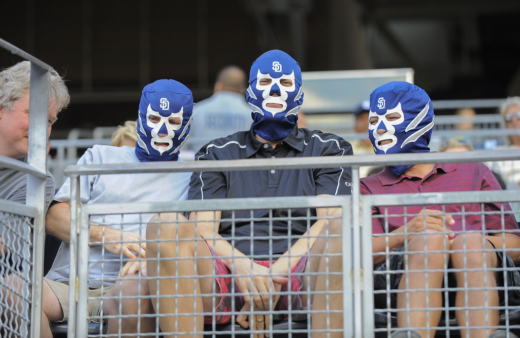 . SAN DIEGO, CA - SEPTEMBER 7:  Baseball fans wear Padres luchador masks during the first inning of a baseball game between the San Diego Padres and the Colorado Rockies at Petco Park on September 7, 2013 in San Diego, California. The masks were part of the Padres Luchador mask night.  (Photo by Denis Poroy/Getty Images)