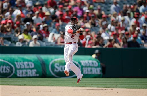 . Los Angeles Angels shortstop Erick Aybar throws to first base for the out on Detroit Tigers\' Eugenio Suarez during the eighth inning of a baseball game on Sunday, July 27, 2014, in Anaheim, Calif. (AP Photo/Jae C. Hong)