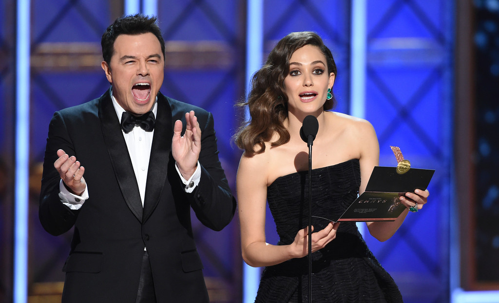 . Seth MacFarlane and Emmy Rossum present the award for outstanding writing for a limited series, movie or a dramatic special at the 69th Primetime Emmy Awards on Sunday, Sept. 17, 2017, at the Microsoft Theater in Los Angeles. (Photo by Phil McCarten/Invision for the Television Academy/AP Images)