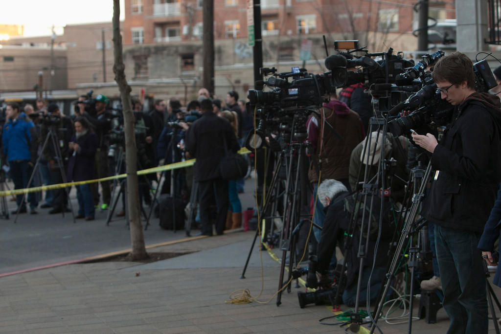 . Members of the media wait where police cordoned off a crime scene related to the shootings at Sandy Hook Elementary School, in Hoboken, New Jersey, December 14, 2012. In Hoboken, New Jersey, police cordoned off a block in connection with the Connecticut shootings but an officer told reporters there was no body inside, contrary to an earlier media report. REUTERS/Andrew Kelly