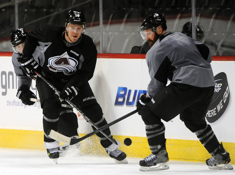 . Colorado Avalanche center Paul Stastny, left, moves the puck past defenseman Greg Zanon, right, during practice January  17th, 2013.tThe Colorado Avalanche hit the ice for the first time this season at the Pepsi Center.  After long months of contract negotiations the season has finally started. Helen H. Richardson, The Denver Post