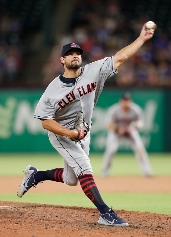 . Cleveland Indians pitcher Brad Hand delivers a pitch to a Texas Rangers batter during the seventh inning of a baseball game, Friday, July 20, 2018, in Arlington, Texas. (AP Photo/Jim Cowsert)