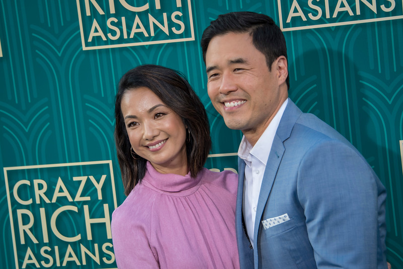 HOLLYWOOD, CA - AUGUST 07: Jae Suh Park and Randall Park arrive at Warner Bros. Pictures' 'Crazy Rich Asians' Premiere at TCL Chinese Theatre IMAX on Tuesday, August 7, 2018 in Hollywood, California. (Photo by Tom Sorensen/Moovieboy Pictures)