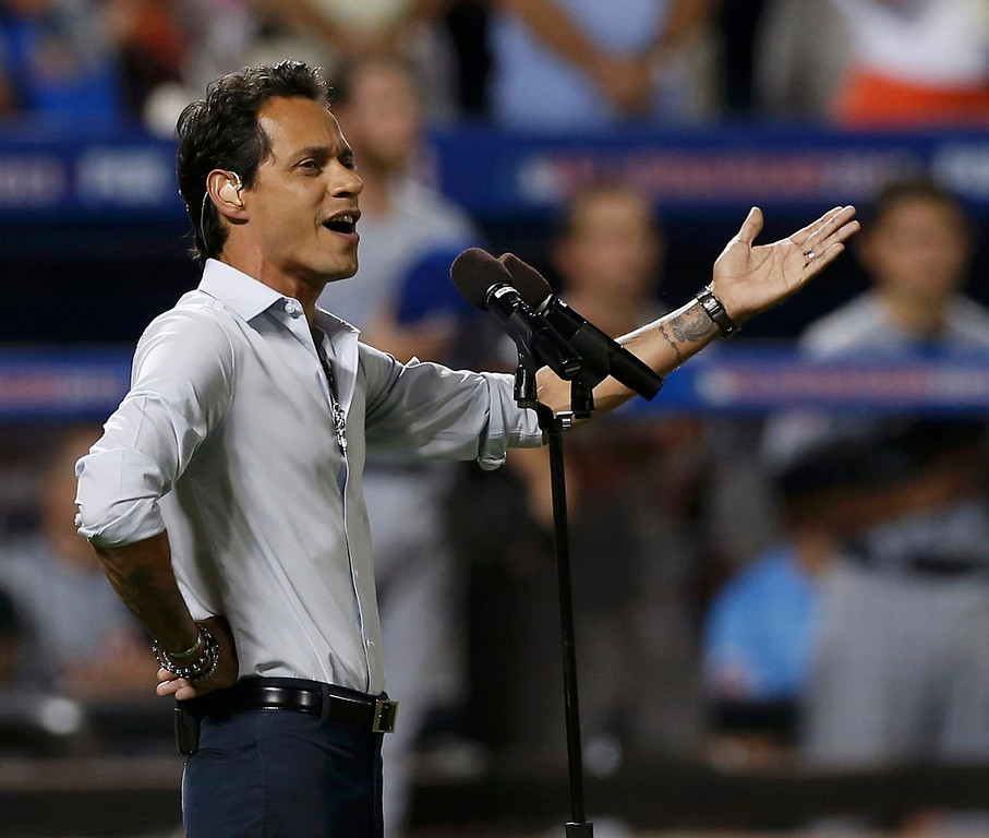 . Marc Anthony sings God Bless America during the seventh inning stretch at Major League Baseball\'s All-Star Game in New York, July 16, 2013. REUTERS/Mike Segar