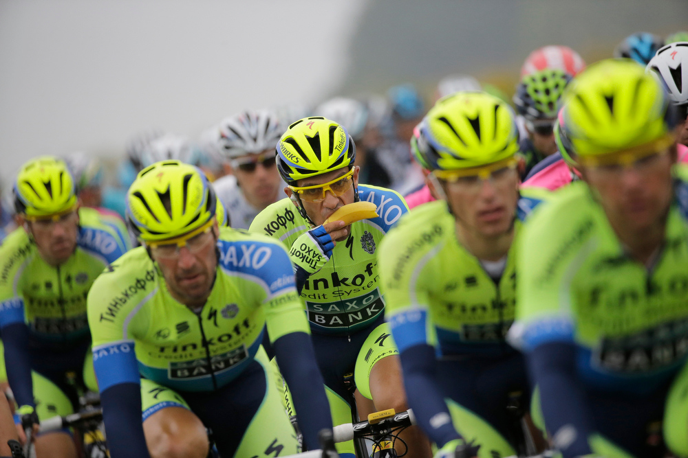 . Spain\'s Alberto Contador eats a banana in as he rides in the pack during the sixth stage of the Tour de France cycling race over 194 kilometers (120.5 miles) with start in Arras and finish in Reims, France, Thursday, July 10, 2014. (AP Photo/Laurent Cipriani)