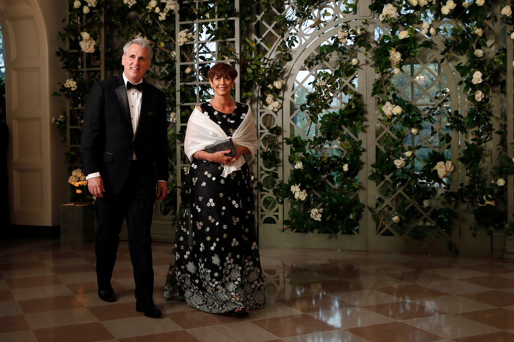 . House Majority Leader Kevin McCarthy of Calif., arrives with his wife Judy McCarthy for a State Dinner with French President Emmanuel Macron and President Donald Trump at the White House, Tuesday, April 24, 2018, in Washington. (AP Photo/Alex Brandon)