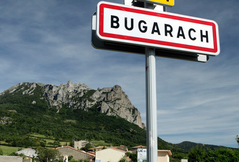 ". This June 24, 2011 photo shows the Bugarach mountain peak in southern France. From Russia to California, thousands are preparing for the fateful day, when many believe a 5,125-year cycle known as the Long Count in the Mayan calendar supposedly comes to an end.  The Internet has helped feed the frenzy, spreading rumors that a mountain in the French Pyrenees is hiding an alien spaceship that will be the sole escape from the destruction.  French authorities are blocking access to Bugarach peak from Dec. 19-23 except for the village\'s 200 residents ""who want to live in peace,\"" the local prefect said in a news release. (AP Photo)"