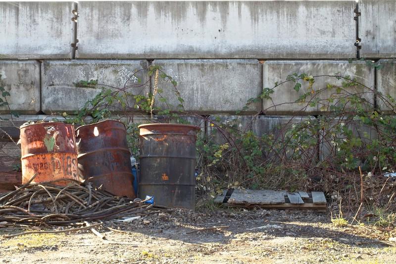 industrial-waste-barrels-white-walls.jpg