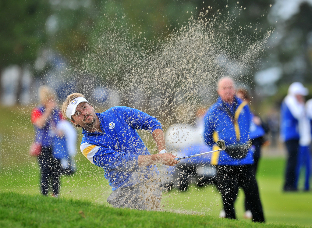 . Victor Dubuisson of France plays from a bunker on the fifteenth hole during the singles matches at Gleneagles in Scotland, on September 28, 2014, during the 2014 Ryder Cup competition between Europe and the USA.  AFP PHOTO / GLYN KIRK