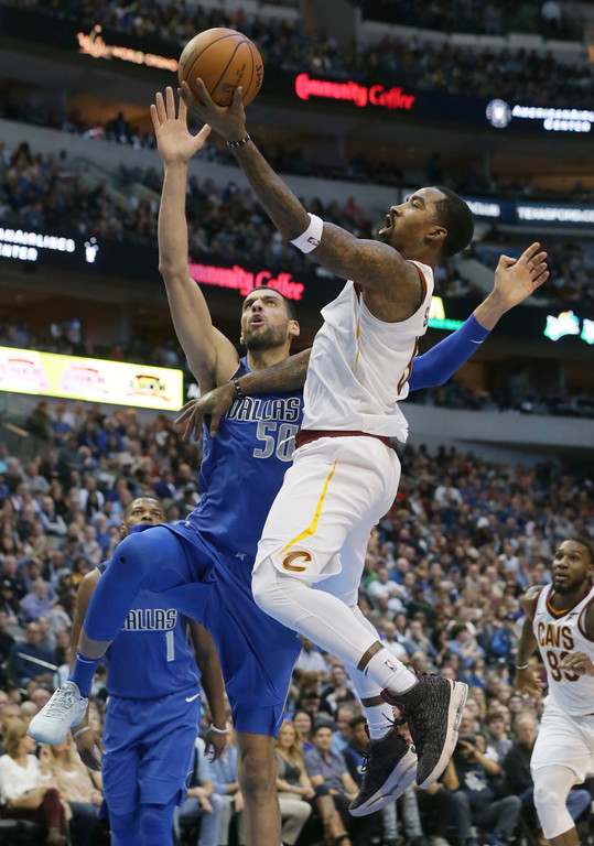 . Cleveland Cavaliers guard JR Smith (5) shoots against Dallas Mavericks center Salah Mejri (50) during the first half of an NBA basketball game in Dallas, Saturday, Nov. 11, 2017. (AP Photo/LM Otero)