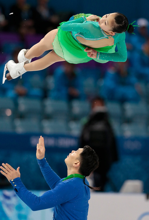 . Peng Cheng and Zhang Hao of China compete in the team pairs short program figure skating competition at the Iceberg Skating Palace during the 2014 Winter Olympics, Thursday, Feb. 6, 2014, in Sochi, Russia. (AP Photo/Ivan Sekretarev)