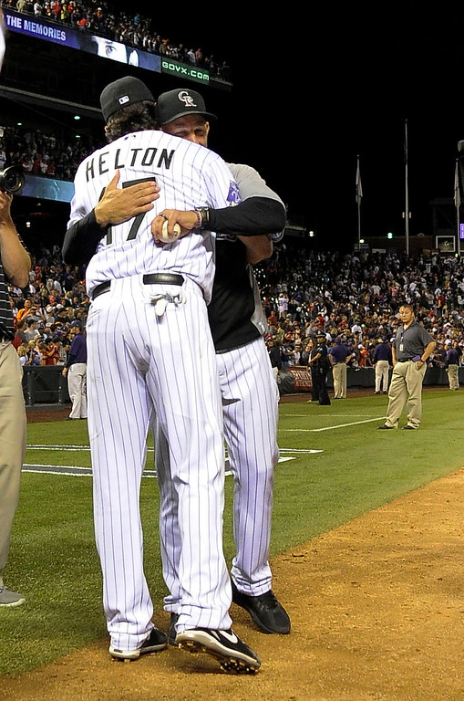 . Todd Helton (17) of the Colorado Rockies gets a hug from Manager Walt Weiss (22) of the Colorado Rockies at the end of the game against the Boston Red Sox September 25, 2013 at Coors Field. Helton will retire at the end of the season after 17 years with the club. (Photo By John Leyba/The Denver Post)