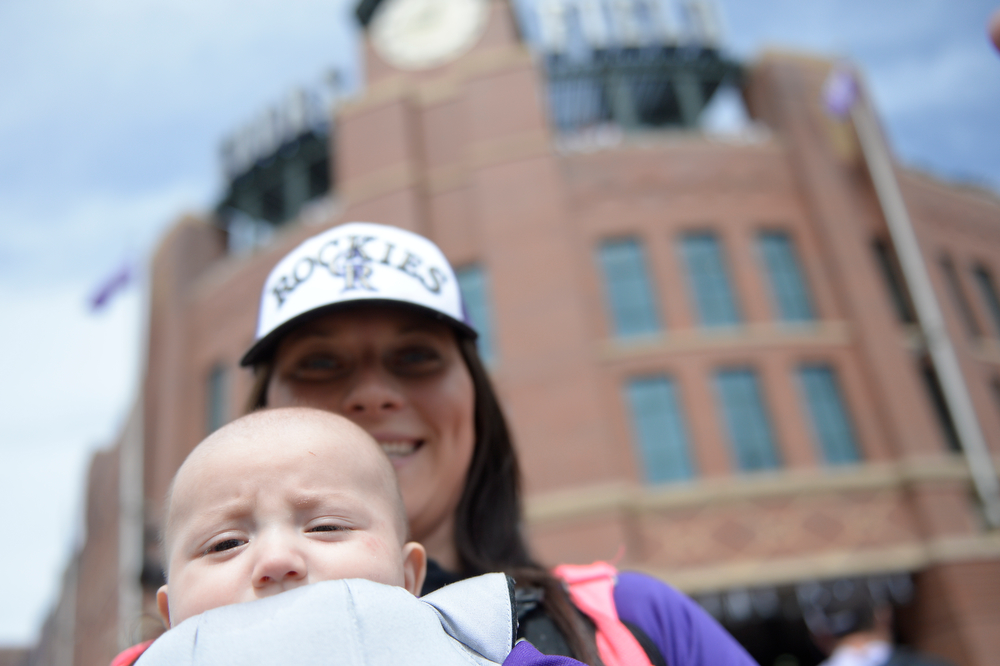 . 4-month-old Ivan Garcia Jr. and his mother Victoria Garcia head into the stadium before the game. The Colorado Rockies hosted the Arizona Diamondbacks in the Rockies season home opener at Coors Field in Denver, Colorado Friday, April 4, 2014. (Photo by Craig F. Walker/The Denver Post)
